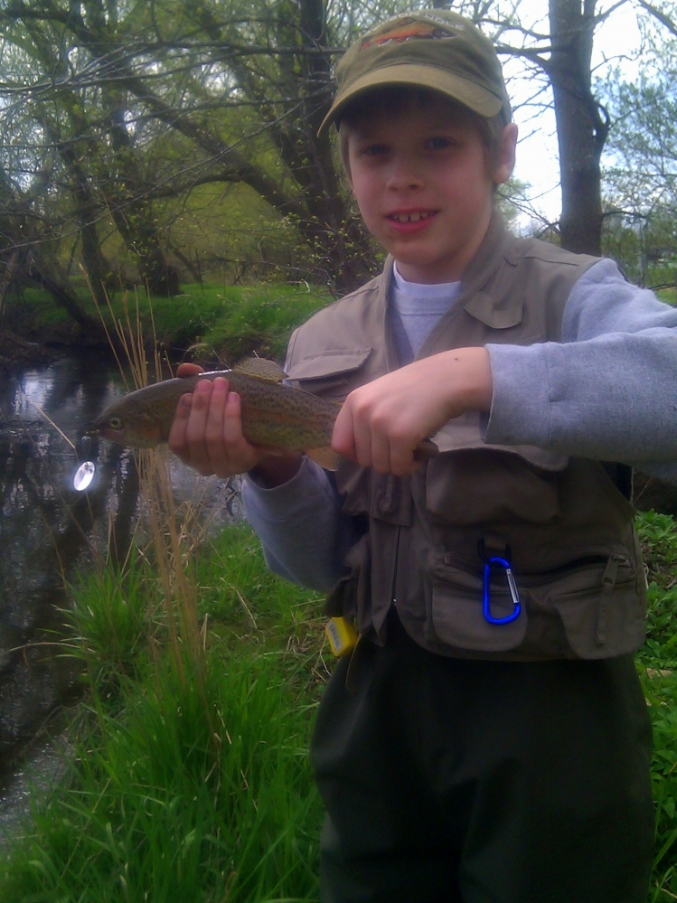 "Bode with his first fish of 2011, a 12"" Rainbow"