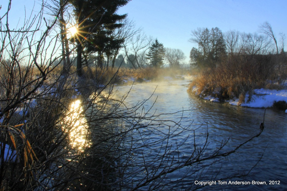 The sun rises over a Driftless spring-fed creek in Wisconsin