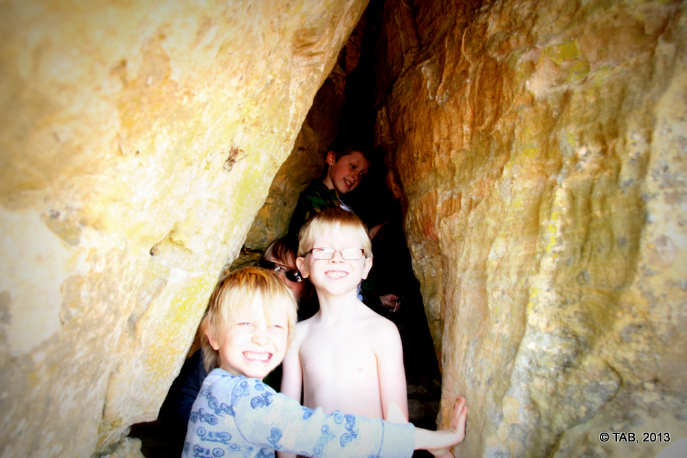 Four boys in a cave, Spring Green Prairie