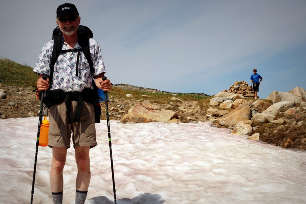 Wes crossing the snowfield at the Continental Divide, East Rosebud Trail