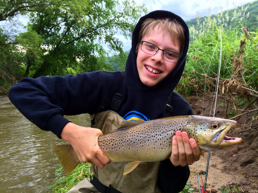 "Bode with a 21"" male Brown Trout, caught in a Vernon County spring creek."